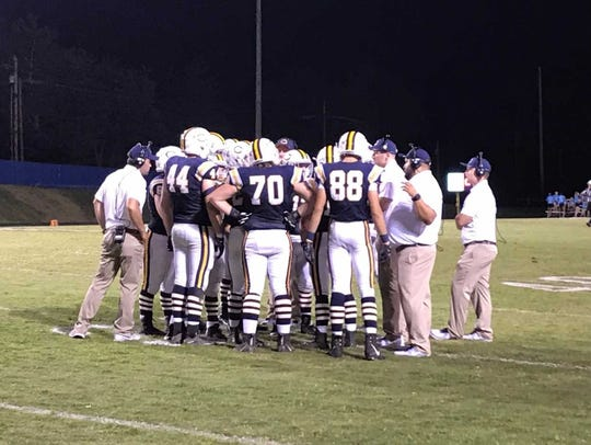 The Castle offense huddles before taking the field