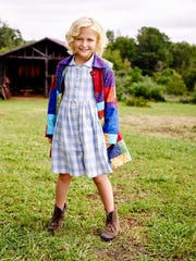 "Alyvia Alyn Lind is Dolly in ""Dolly Parton's Coat of Many Colors."""