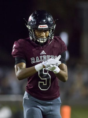 Dante Wright (5) celebrates after scoring a touchdown as the Raiders take a 7-0 lead during the Escambia vs Navarre high school football game in Navarre on Friday, October 6, 2017.