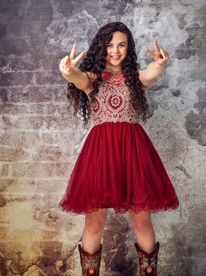 """Farmington's Chevel Shepherd flashes a victory sign after a recent successful appearance on the """"The Voice."""""""
