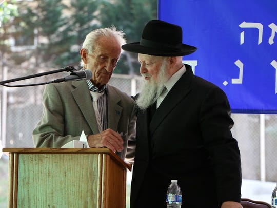 Rabbi Moshe Herson, dean of the Rabbinical College of America, congratulates Ed Mosberg of Parsippany, the presenter of a 200 year old Torah Scroll at graduation ceremonies on  June 26, 2016.