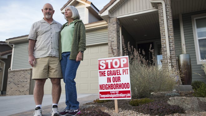 Terry and Cristi Baldino pose for a portrait outside their Johnstown home on Tuesday, October 24, 2017. The pair, along with a group of neighbors, are protesting a proposed gravel pit near their neighborhood due to concerns it will impact their quality of life.