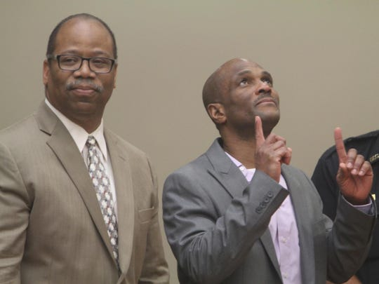 """Charles """"Teddy"""" Pierre was acquitted of all the retrial in two murder charges in Monroe County Court in Rochester, NY on August 13, 2015. The jury also found him not guilty on arson charges. With him is his attorney Van Henri White. Pierre reacts several times including pointing up towards God after the jury verdict reading. Earlier he had made the sign of the cross."""