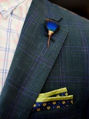 Feather details add color to a suit from John Pickens