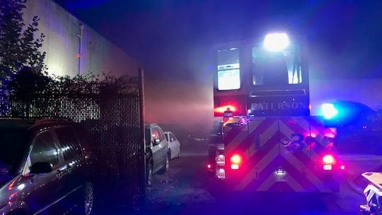 A Paterson Fire Department vehicle at the scene of a brush fire that caused smoke damage at a factory on 31st Street.