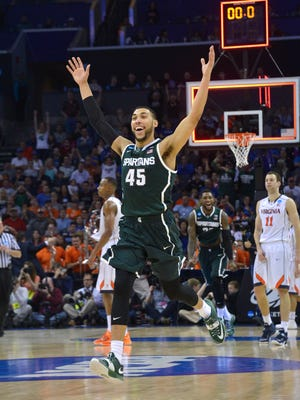Denzel Valentine celebrates when the buzzer sounds as Michigan State beats Virginia, 60-54, at Charlotte, North Carolina, on Sunday. The Spartans have shown they're rapidly improving.