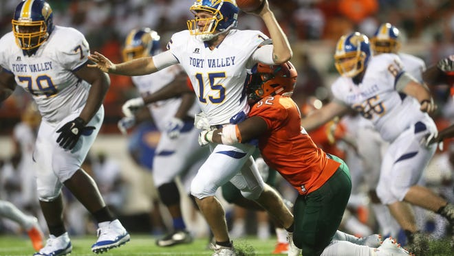 FAMU's Derrick Mayweather drags down Fort Valley State University's Slade Jarman for the sack as the Rattlers win 41-7 to open the season at Bragg Memorial Stadium on Saturday, Sept. 1, 2018.