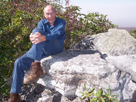 Howard McDonald, seen here on his favorite rock on the Appalachian Trail. McDonald, 89, has dedicated his retirement years to building and maintaining hundreds of miles of trail in Western North Carolina with the Carolina Mountain Club.