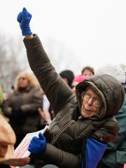 Carolyn Doherty, 80, of Royal Oak cheers Sunday, Jan.