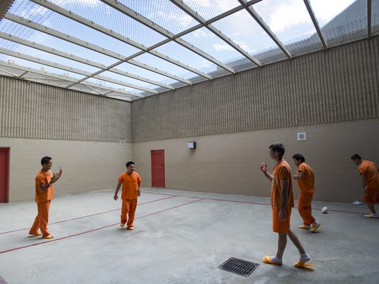 Inmates play a game of hand ball in an outdoor recreation yard at Larimer County Jail Friday, September 30, 2016.