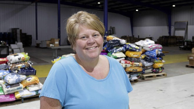 Sheboygan County Food Pantry executive director Liz Kroll poses inside the new facility Thursday Oct. 20, 2016 in Sheboygan.