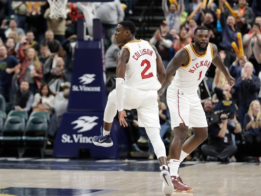 Indiana Pacers' Darren Collison (2) and Lance Stephenson react following a basket during the second half of an NBA basketball game against the Detroit Pistons, Friday, Nov. 17, 2017, in Indianapolis. Indiana won 107-100. (AP Photo/Darron Cummings)