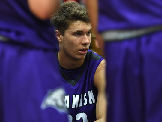 Spanish Springs' Jalen Townsell listens to the coach during a time-out during a recent game against McQueen on Jan. 9.