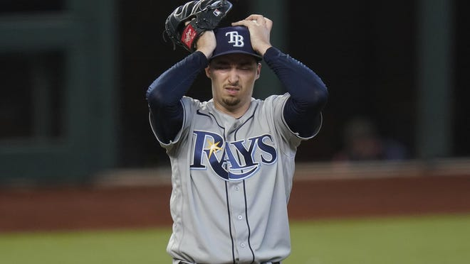 Tampa Bay Rays starting pitcher Blake Snell reacts after giving up two-run home run on Wednesday in Arlington, Texas.