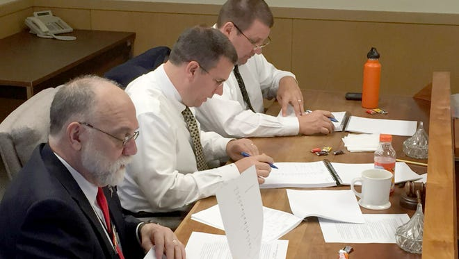 The Lebanon County Board of Elections (from front to back) President Judge John C. Tylwalk, county administrator Jamie Wolgemuth and Judge Charles T. Jones Jr. tabulate the results of Tuesday's Primary Election.