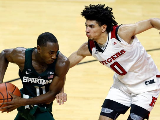 Rutgers Scarlet Knights guard Geo Baker (0) defends