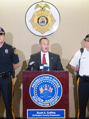 Willingboro Police Department Capt. James McKendrick, left, and Medford Police Chief Richard Meder, right, join Burlington County Prosecutor Scott Coffina as he unveils  a new initiative to fight violent crime.