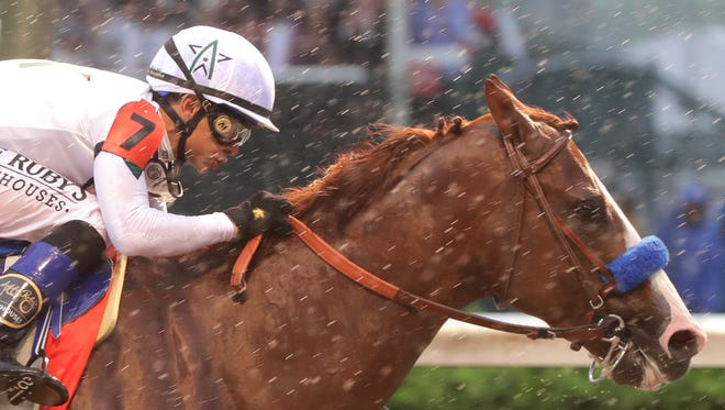Justify, ridden by Mike Smith, wins the 144th Kentucky Derby. 