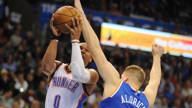 Oklahoma City Thunder guard Russell Westbrook attempts a shot against Knicks center Cole Aldrich during the third quarter at Chesapeake Energy Arena Friday night.