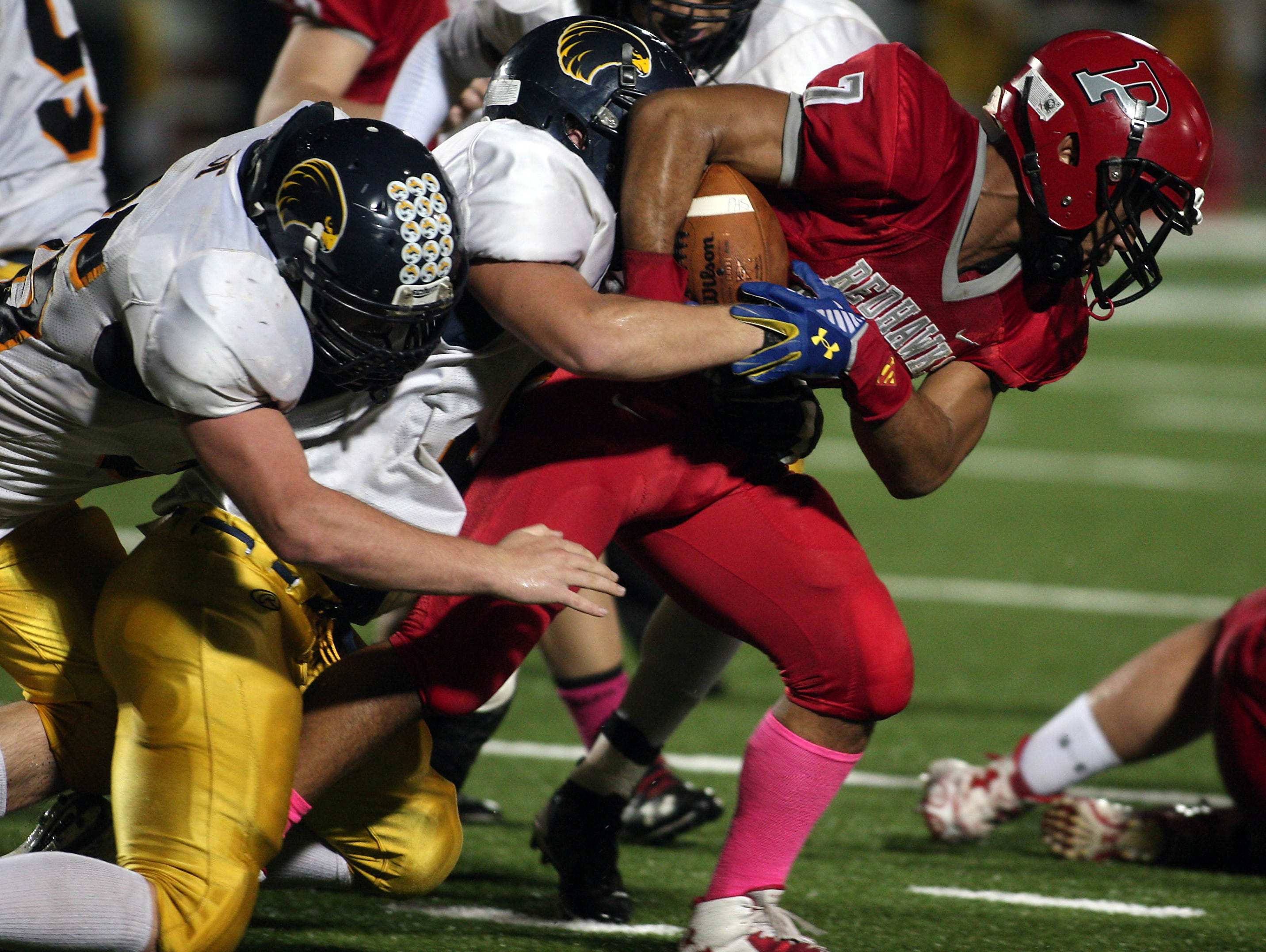 Parsippany running back Nigel Feliz gains yardage on a carry vs Jefferson in a Friday night football matchup. October 9, 2015, Parsippany, NJ.