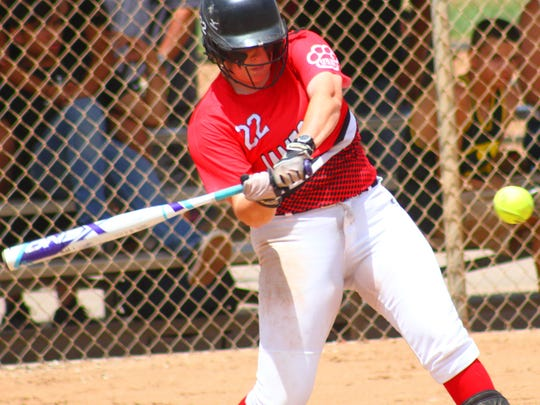 Sierra Gentry of the James Gang swings at a pitch during pool play Saturday afternoon at the Travis C. Hooser Ballfield Complex.