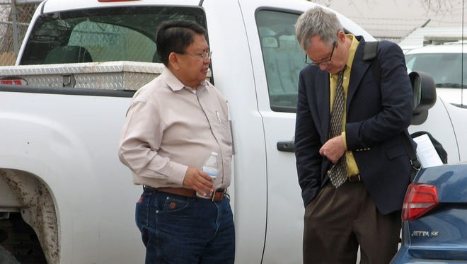 Navajo Nation Council Delegate Mel R. Begay, left, meets with his attorney, Jeffrey Rasmussen, after court recessed on Tuesday in Window Rock, Ariz.