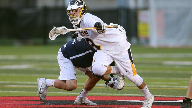 Victor's T.D. Ierlan, a junior who has verbally committed to play at State University of Albany, wins this draw against Webster Thomas during the Section V Class B Championship May 27.
