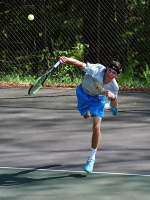 Essex's David Wrenner fires a serve during his match against St. Johnsbury's Takanori Tanifuji on Monday in St. Johnsbury.