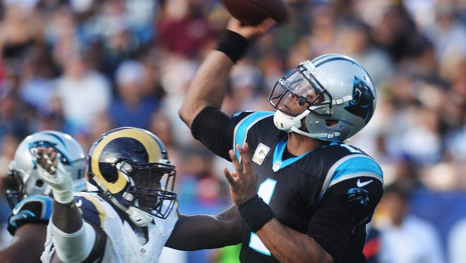 Rams defensive end William Hayes (left), shown pressuring Panthers quarterback Cam Newton last season at the Coliseum, was traded on Thursday night to the Miami Dolphins.
