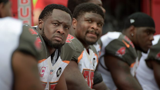 Tampa Bay Buccaneers defensive tackle Gerald McCoy, left, has signed the richest deal at his position in league history.