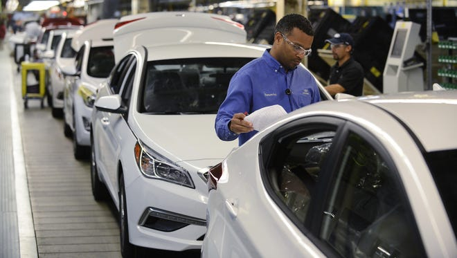 Production workers build Sonata and Elantra sedans at Hyundai Motor Manufacturing Alabama. The Santa Fe Sport was recently added to the plant's production mix.