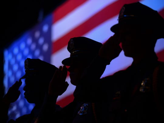 Law Enforcement Explorers stand in salute at the Boy