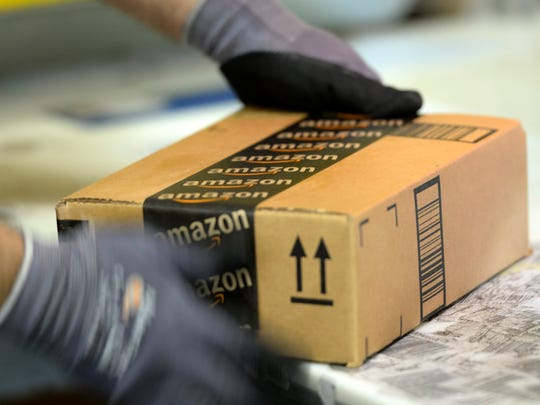 FILE - NOVEMBER 13, 2014: According to reports, Amazon and Hachette have signed a new contract, resolving a dispute over e-book pricing. Hachette opposed book sale concessions imposed by Amazon, which lead to delayed deliveries to Hachette customers. SAN BERNARDINO, OCTOBER 29:  An employee prepares order at Amazon's San Bernardino Fulfillment Center October 29, 2013 in San Bernardino, California. Amazon's 1 million-square-foot facility in the economically hard-hit San Bernardino County has created more than 800 jobs at the center. Fulfillment centers are where products sold by other vendors on Amazon.com store their inventory. (Photo by Kevork Djansezian/Getty Images) ORG XMIT: 503816393 ORIG FILE ID: 186224734
