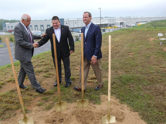 Tom Allen, left, Anderson County Council, shakes hands with Jhan Nixon, middle, TTi vice president of Facilities, near Lee Sowell, right, president of TTi Outdoor Power Equipment, after the Techtronic Industries (TTi) Outdoor Test Lab ground breaking in Anderson.