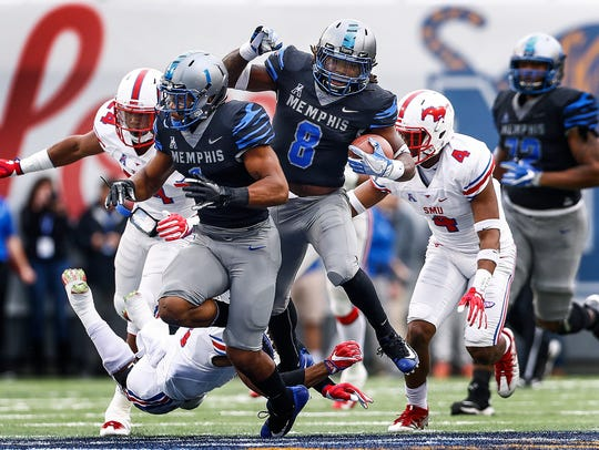 After getting a block from teammate Tony Pollard (left), Memphis running back Darrell Henderson (right) runs past the SMU defense for a 70-yard touchdown in the 2017 season.