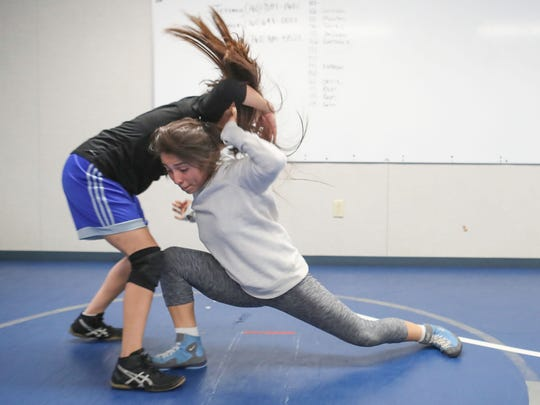 Britney Garnica, right, practices with a teammate during Cathedral City HIgh SchoolÕs girls wrestling practice, January 30, 2018.
