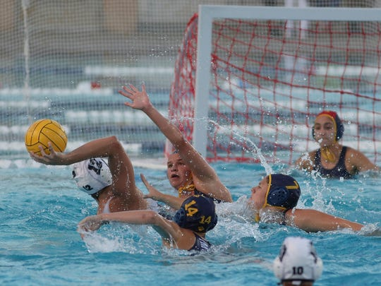 Jill Barbato, 12, of Xavier shoots against La Quinta during the DVL championship water polo match, February 7, 2018.
