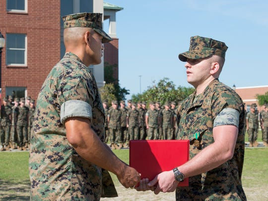 Marine Maj. Javier Garcia, left, presents the citation