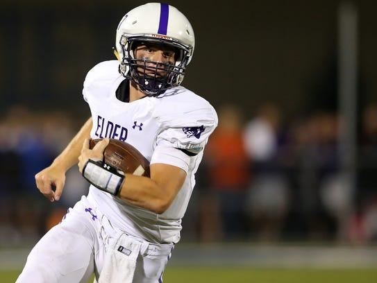 Elder quarterback Michael Bittner (17) carries the