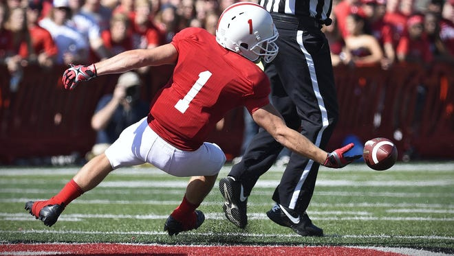 The ball goes just out of reach of Josh Bunkum of St. John's University during Saturday's game at Clemens Stadium in Collegeville.