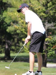 Milford's Christian Golich takes aim with a putt during