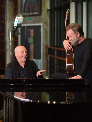British musicians Peter Gabriel, left, and Sting, at the Real World Studios in Box, England on Monday Jan. 4, 2016.