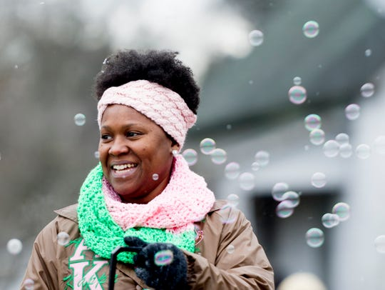 Carla Rogers, of Houston, Texas, blows bubbles during