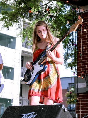 Madison Fields tears it up with band Wild Planet at a local Urban Outfitters benefit show.