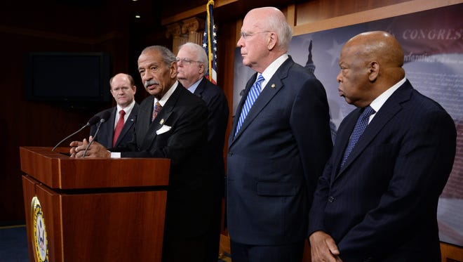 Rep. John Conyers, D-Mich., speaks at a Jan. 16 news conference to introduce legislation to restore a provision of the Voting Rights Act, joined by, from left, Sen. Chris Coons, D-Del., Rep. Jim Sensenbrenner, R-Wis., Sen. Patrick Leahy, D-Vt., and Rep. John Lewis, D-Ga.