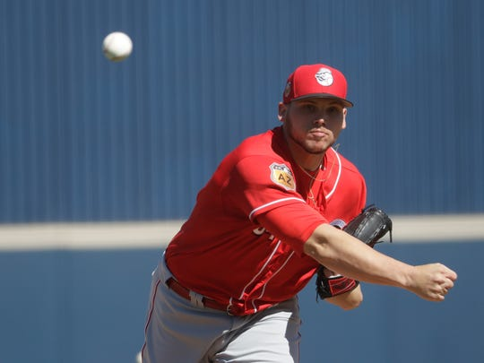 Cincinnati Reds' Rookie Davis throws during a spring training baseball game Wednesday, March 1, 2017, in Phoenix. (AP Photo/Morry Gash)