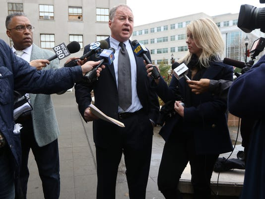 Bill Brennan speaks to press.JPG