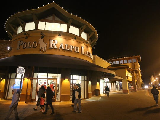People shop at the Woodburn Premium Outlets on Thursday, Nov. 27, 2014, in Woodburn.
