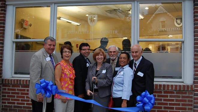 President and CEO Eva Turbiner, center, at the 2010 opening of Zufall Health Center's new Morristown site.