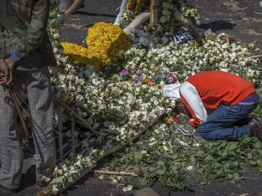 An Ethiopian relative of a crash victim mourns and